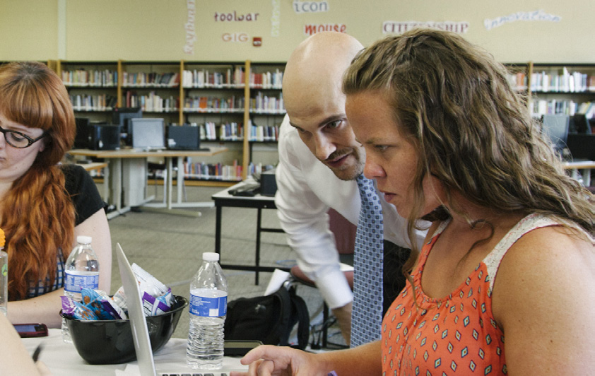 Teacher Autumn Laidler and Principal Castelaz analyze 5Essentials data.